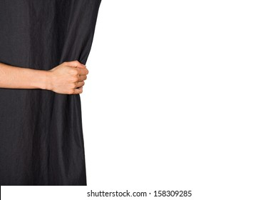 Hand opening black curtain. Isolated on white background.