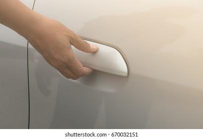 hand opening car door.