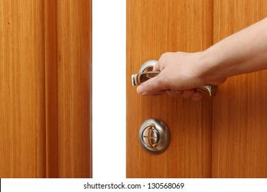 Hand opening the door. Horizontal format