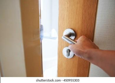hand opening door knob, slightly open