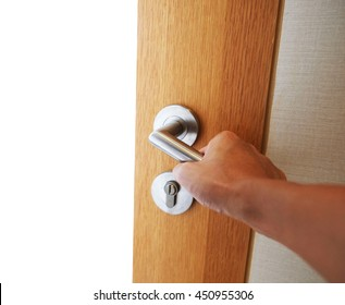 hand opening door knob with white background dream concept