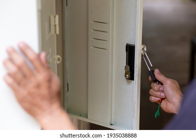 The hand is opening the locker.