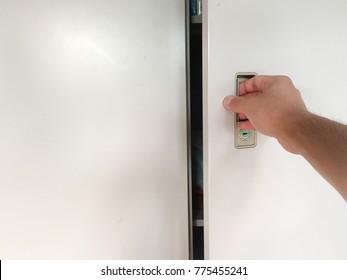 hand opening the locker door.Hand with Key Open Locker