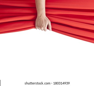 hand opening red curtain on white.