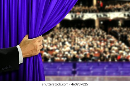 Hand opening stage curtain and audiance