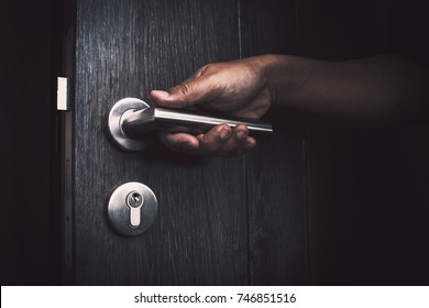 hand opening unlock the door