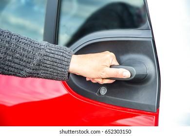 Hand opens car door