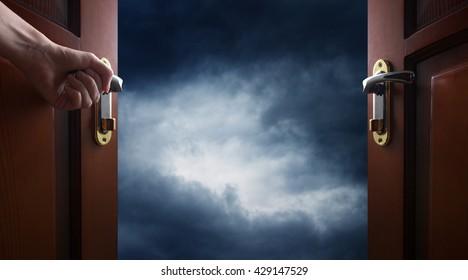 hand opens room door to sky
