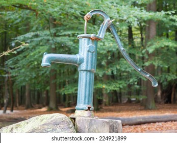 Hand operated water pump, rusted and forgotten