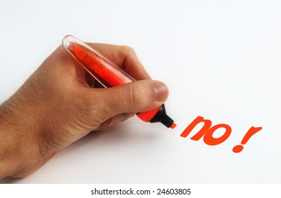 Hand and orange pen writing the word no on white paper