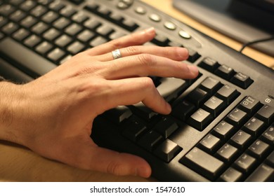 hand over black computer keyboard
