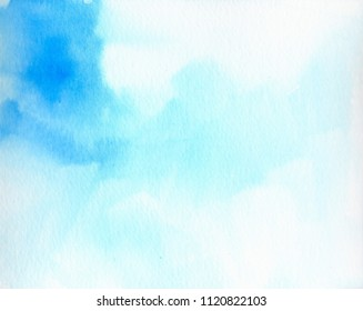 Hand painted airy watercolor wash background in light blue colors.