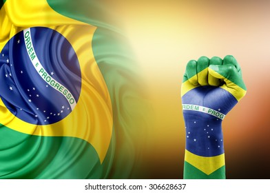 hand painted with brazil flag erected in victory sign