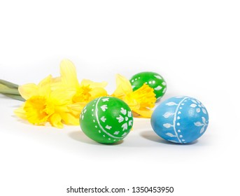 Hand painted Easter eggs and daffodils isolated on white background