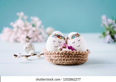 Hand painted eastereggs in easternest with fresh blue background and copyspace