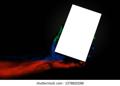 hand with painted flag Dagestan holding a large white sheet with space for an inscription, mock up. Horizontal frame