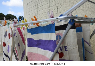Hand painted handbags drying in the sun