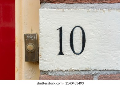 Hand painted house number ten (10)