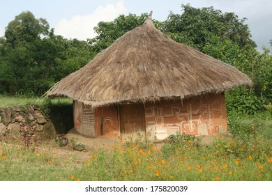 A hand painted mud hut with thatch roof is home to a tribal family in Ethiopia