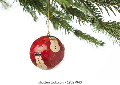 Hand painted ornament hanging from a Christmas tree branch
