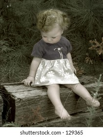 hand painted vintage look-toddler sitting on a crosstie