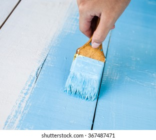 hand painting wood with blue color