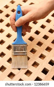 Hand painting wooden furniture piece
