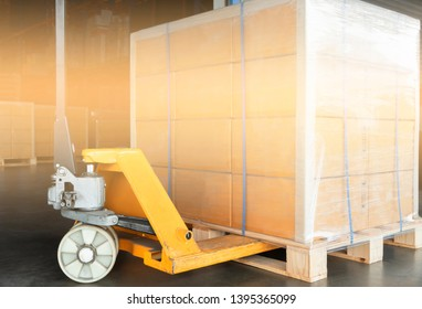 Hand pallet truck or pallet jack with the shipment pallet.