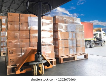 hand pallet truck or manual forklift with the shipment pallet for load into a truck.