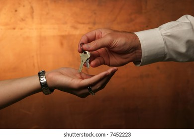 hand passing keys to other hand