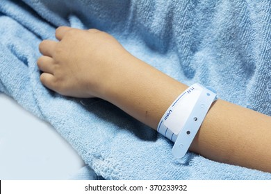 hand with patient identification bracelet