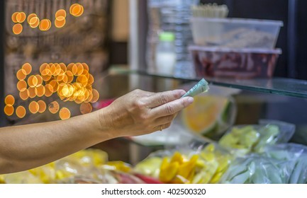 Hand paying with money