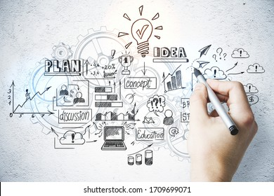 Hand with pen drawing charts and business concept on wall. Finance and education concept.