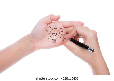 Hand with pen write idea light bulb  isolated on white background