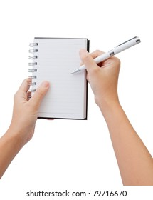 Hand and pen write on the note book isolate white background