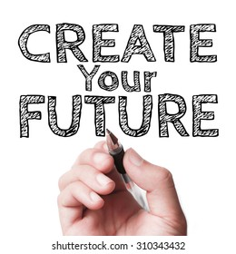Hand with pen is writing the text Create your future on the transparent whiteboard.
