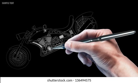 hand with the pencil drawing cad . engineer working on  concept  motorcycle