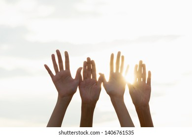 Hand of people arm raising up showing power strong with sky background.