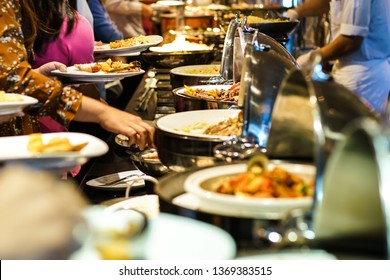 Hand of people take buffet food in hotel party, Food and drink