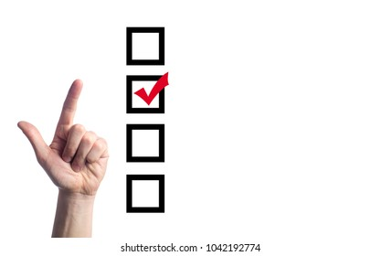 the hand of the person chooses and puts a tick, the person at elections. choosing one with four options. presidential and parliamentary elections