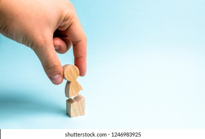 The hand of the person collects a figure of the person together. Psychological assistance and support. Treatment of psychological and emotional trauma. Violence against people, rehabilitation.