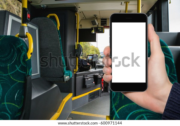 Hand with phone on the background of the city bus. The idea for the app purchase an e-ticket for public transport
