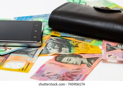 hand phone with wallet on australia banknotes for financial concept