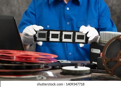 hand photographer digitize a film slide 35mm for saving