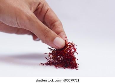 Hand Pick Saffron Over White Background
