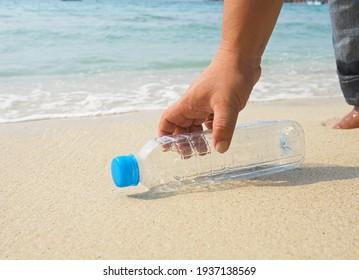 hand picked plastic bottle waste on beach,garbage is on beach