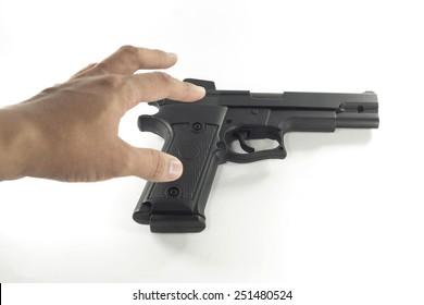 hand picking a handgun