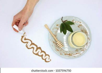 Hand picking handmade lip balm made with cocoa and beeswax