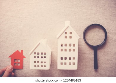 hand picking the right house property, house searching concept