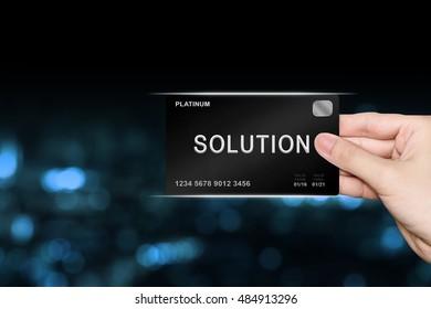 hand picking solution platinum card on blur background